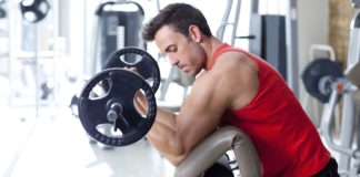 Build Bigger Biceps With This Preacher Curl Workout STACK